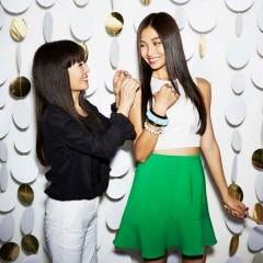 Smooth hair specialist Yuko smiling and attending to a happy model with long, straight smooth hair